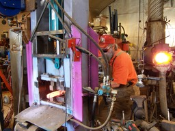 WORKING AT THE HYDRAULIC FORGING PRESS
